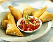 Tiropitakia (Greek turnovers) and tomato salad with ouzo