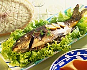 Stuffed carp a la Pomian on bed of lettuce