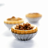 Small nut tartlets in tart tins