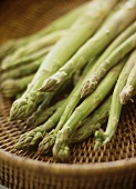 Green asparagus on a wicker tray