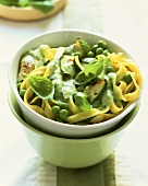 Tagliatelle with courgettes, peas and basil cream