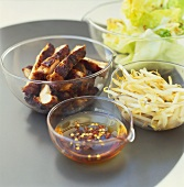 Honeyed chicken breast strips with chili sauce & soya sprouts