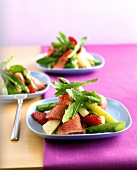 Asparagus salad with strawberries and duck breast