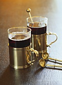 Two glasses of mulled wine, brass spoon