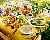 Easter table laid with sweet and savoury dishes (Poland)