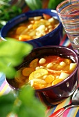 Vegetable soup with tomatoes, root vegetables and beans