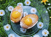 Two small egg cakes (sponge buns with lemon curd cream)