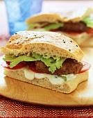 Lamb burger (flatbread sandwich with lamb burger and salad)