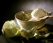 Still life with piece of white cabbage and grated cabbage