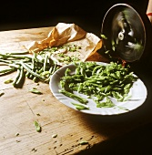 Slicing green beans with a bean slicer