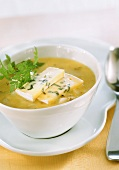 Polenta and pear soup with chervil and blue cheese