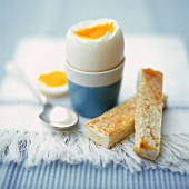 Boiled breakfast egg with buttered toast soldiers