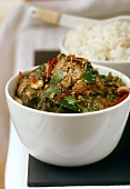 Green chicken curry and a bowl of rice