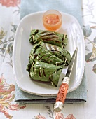 Barbecued banana leaf parcels with vegetable rice filling