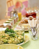 Potato and bean salad with rocket on buffet table