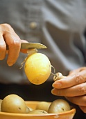 Peeling potatoes with peeling fork and knife