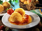 Apricot dumplings (made from potato dough) on fruit puree