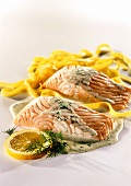 Salmon fillets with ribbon pasta and cream and dill sauce