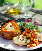 Barbecued chicken breast with vegetable sauce; baked potato