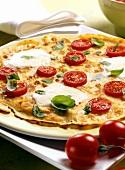 Pancakes with tomatoes, mozzarella and basil