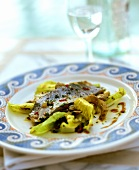 Marinated sea bass with artichokes and lettuce