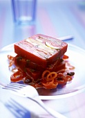 Mediterranean vegetable terrine on red wine onion-raisin sauce