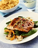 Salmon steak with lime & chili marinade on mangetout salad