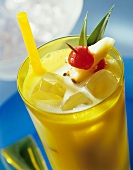 Coconut and pineapple drink with fruit juice ice cubes