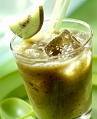 Kiwi fruit & banana drink with ice cubes and straws in glass