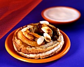 Puff pastry with pears, almonds and almond sabayon
