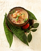 Coconut milk soup with shrimps and tomatoes