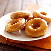 Doughnuts with glacé icing on a plate