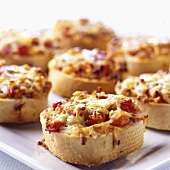 Small cheese and tomato toasts