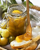 Greengage jam on bread and in preserving jar