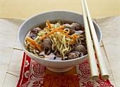 Quick Asian noodle soup with forcemeat balls