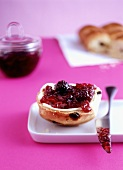 Raisin buns with blackberry jam