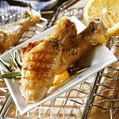Barbecued chicken legs with herbs and lemon