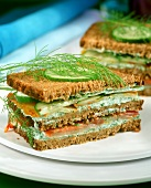 Wholemeal herb spread and smoked fish sandwiches