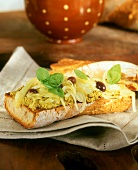 Baguette with olive cream, olives and onions