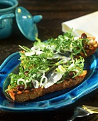 Toasted bread with sardines, olives and herbs