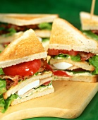 Club sandwiches on wooden boards