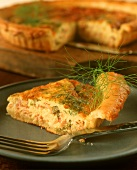 A piece of mini-quiche with smoked salmon and dill