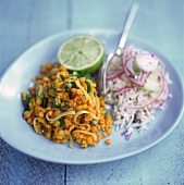 Lentil curry with rice and onions