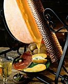 Traditional Swiss raclette with melting cheese