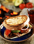 Toasted beef, tomato and avocado sandwich
