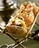 Flatbreads filled with shrimps, mango and herbs