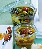 Pickled vegetables (behind) and marinated peppers