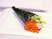 Temaki-sushi with salmon caviare and avocado