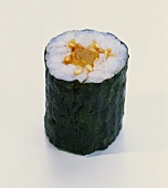 Hosomaki-sushi with bottled pumpkin and sesame seeds