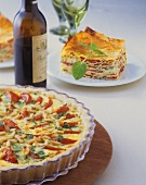 A tomato quiche and a piece of savoury tomato pie